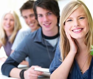 Portrait of a young guys and girls smiling sitting one after another